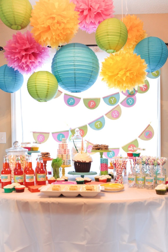 Hanging twine lines at three different heights and then hang the lantern/ paper flower.  Use above the buffet table.  This is so festive and would look great in fiesta colors!
