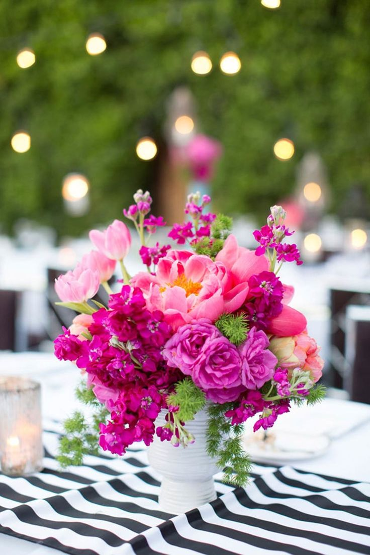 Floral Arrangement ~ Pretty coral, hot pink and purple centerpiece. Photography: Jen Lauren Grant From Birds Of A Feather Photography - birdsofafeatherphoto.com