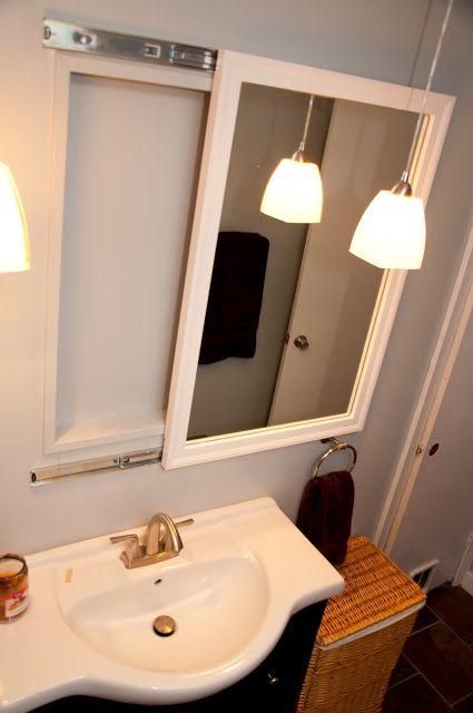 Mirror on drawer tracks for 'hidden' medicine cabinet