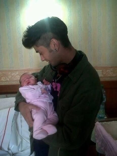 """Imagine it's 3 in the morning and your and Zayn's baby wakes up crying you start to get up and Zayn tells you to stay put. He rocks the baby until she falls back asleep and then smiles down at her saying """"she looks just like you, she's gorgeous."""""""