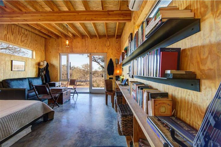 Wood, wood, wood...oh, I love the wood. Yards of books and exposed beams - yes.