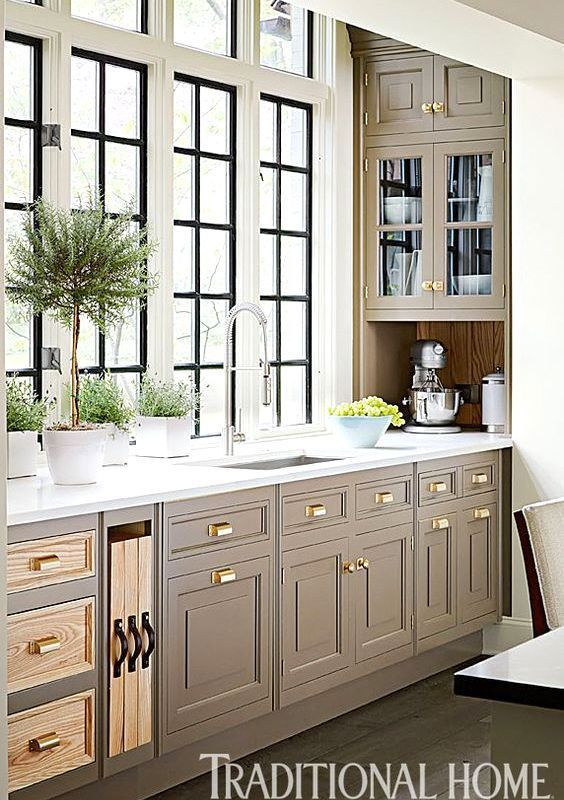 Taupe Kitchen Cabinets Like the idea of dark windows with grid in pure white trim.