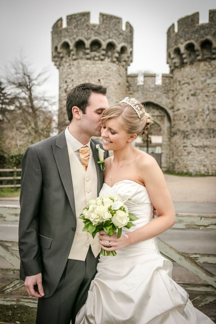 Bride and groom outside Cooling Castle on an early Spring day.