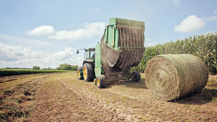 Round Baling - Racing Rain - John Deere 7600 & 566 Round Baler on this episode of How Farms Work #FarmLife #AgProud