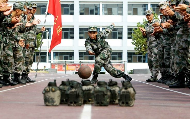 """Soldiers of Chinese People's Liberation Army """"bowl"""" during China's seven-day National Day holiday in Jinan, Shandong province. (China Daily/via Reuters) Oct. 3rd, 2013"""