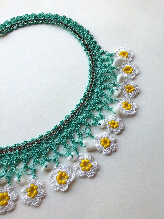 Handmade crocheted necklace decorated with cute crochet flowers and natural ston…