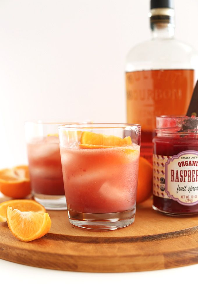 Raspberry Jam Bourbon Smash - Raspberry Preserves, Bourbon, Triple Sec, Orange Juice, Club Soda, Orange Wedges.