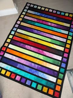 Jelly Roll quilt; not really colors I'd go for in a quilt but I think it is pretty frames in the black.