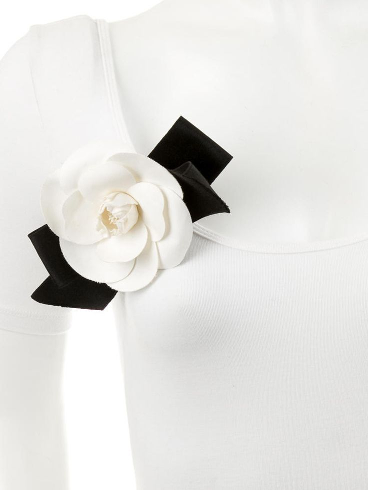 Black satin and creme canvas Chanel camellia brooch with pin closure. Includes box.