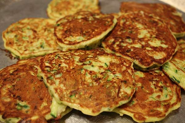 Zucchini Pancakes - Similar to potato pancakes, with less carbs and a perfect side dish with grilled chicken or meat.