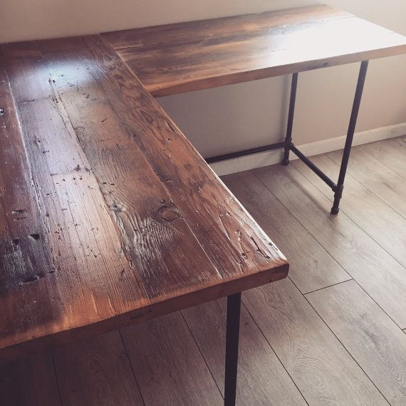 Reclaimed Douglas Fir L shaped desk. - Shown with industrial pipe legs left raw with a clear enamel coating to prevent rusting. - Many different