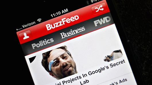 Story links are displayed on a business page of the BuzzFeed app on an Apple Inc. iPhone 5 in Tiskilwa, Illinois.
