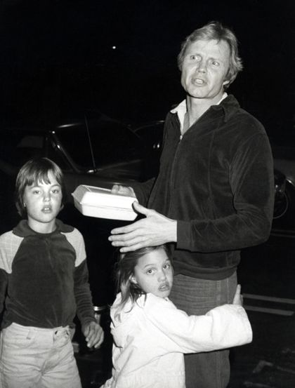 Angelina Jolie hugging her dad Jon Voight with brother James