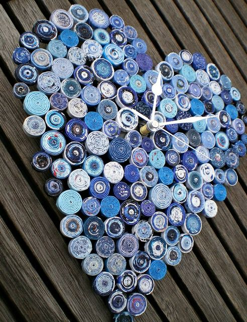 Recycled Paper Clocks. Funky/cool clocks that Carolyn Lodge creates from used magazines and wrapping paper.