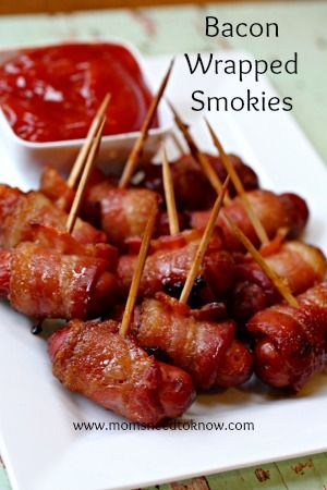 Bacon wrapped smokies with a brown sugar glaze.  The perfect mix of sweet & salty and great for NYE parties!