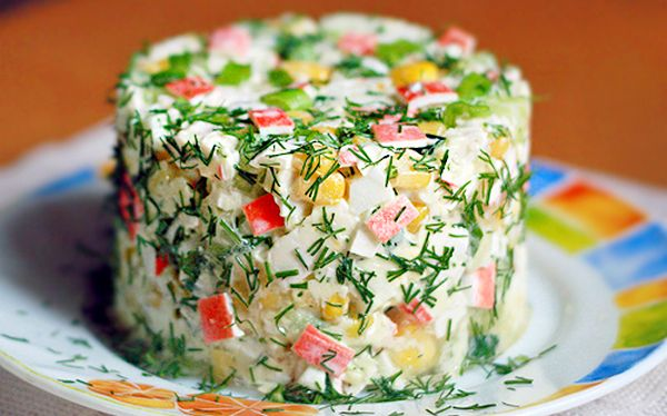 Salad with crackers and crab sticks