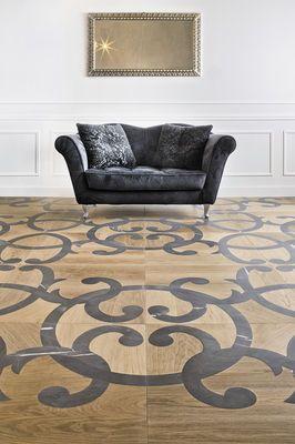 Pavimento intarsiato in legno e marmo grigio, design ARA.Finitura naturale.Come tutta la nostra produzione è una creazione artigianale realizzata sumisura e disegnata per adattarsi perfettamente alla superficie edesprimere lo stile...