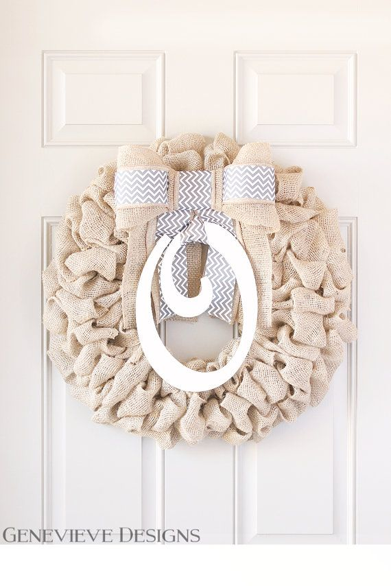 """Front doors are a portal to your personality - not just your house. This simple, yet elegant wreath is handcrafted with the highest quality materials on the market with obsessive attention to detail. I am proud to offer wreaths made with untreated, natural burlap. You deserve only the best on your doors.   - 24"""" burlap wreath with soft backing to protect door or wall - Premium exterior grade coated interchangeable wood initial - Interchangeable bow with heavy duty snaps for quick changes…"""