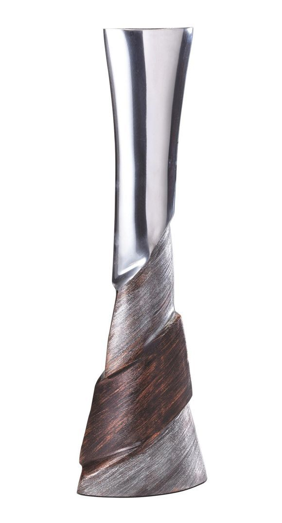Diese vase aus aluminium wird sie und ihre gäste begeistern die farbgebung in schwarz und