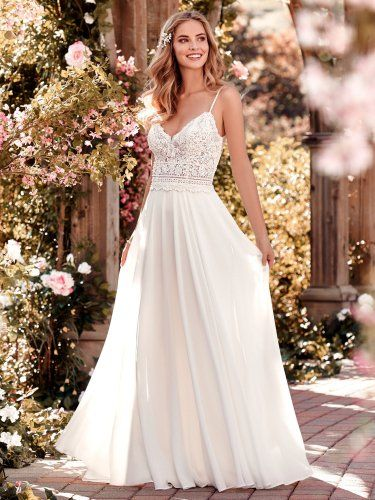 Rebecca Ingram - juniper, This chiffon boho-inspired wedding dress features a sheer bodice accented in beaded lace atop an Aria Chiffon skirt. A V-neck, V-back, and beaded spaghetti straps complete this sheath gown. Finished with crystal buttons and zipper closure.