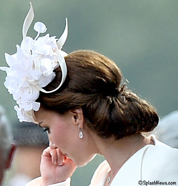 The Duchess of Cambridge's updo and Jane Taylor hat worn for the christening of Princess Charlotte July 5, 2015.