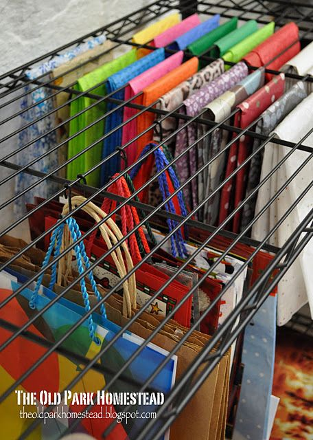 Using metal shelves to store fabric (here they used wrapping paper).