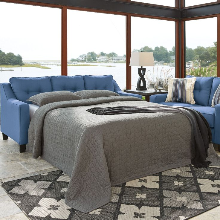 Ivy Sectional Sofa Bed only $1399 including tax & free local delivery! #sofa #palluccifurniture https://www.palluccifurniture.ca/ivy-reversible-sectional-queen-sofa-bed-blue/