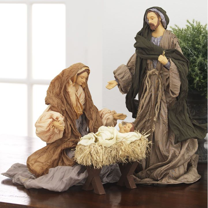 "Taffeta Holy Family - from Unique Nativity; Made of taffeta and resin, it measures 13.5""."