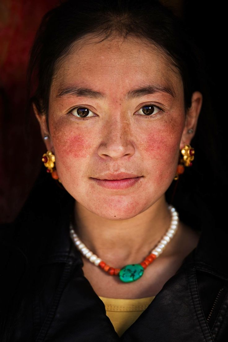 Although she was home in her isolated village, cleaning her house, this mother of two children was incredibly elegant and graceful. That's exactly how I found her, after I knocked on her door.  Tibetan women, with their red cheeks caused by the rough climate, remind me of ancient paintings. Through their powerful eyes you can feel their inner beauty.  I took this photo in October 2015, in Sichuan Province, China.