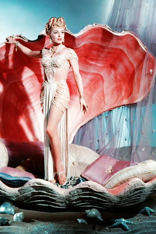 The Prodigal - Lana Turner as Samarra wearing a white pearl costume with front draping on the skirt.