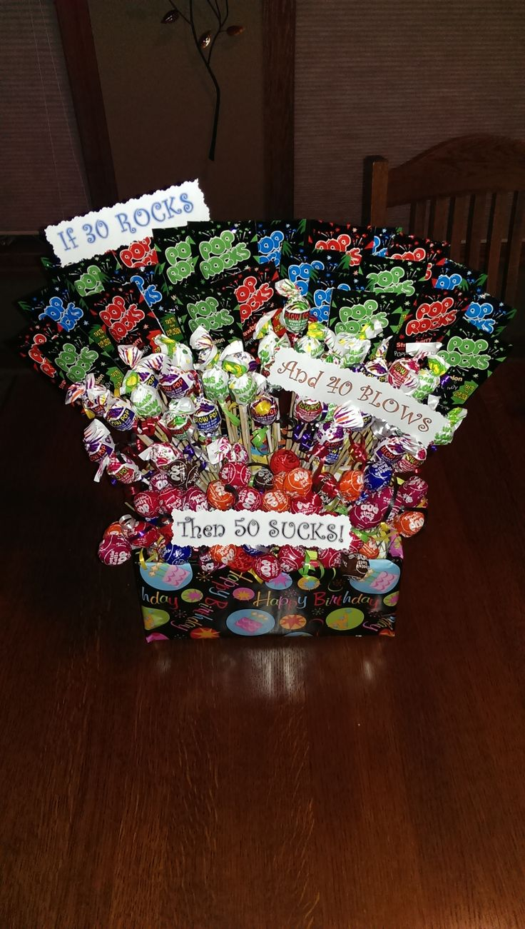 30 Rocks 40 Blows 50 Sucks  Fun 50th birthday gift / centerpiece.  Consists of 30 packages of PopRocks, 40 Blow pops and 50 Tootsie roll suckers.  Some people switch it to 50 Rocks, but I was being funny to the birthday girl :)