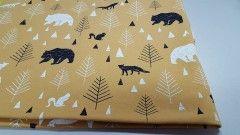 Dzianina dresowa pętelka niedźwiedzie, lisy, choinki na musztardzie