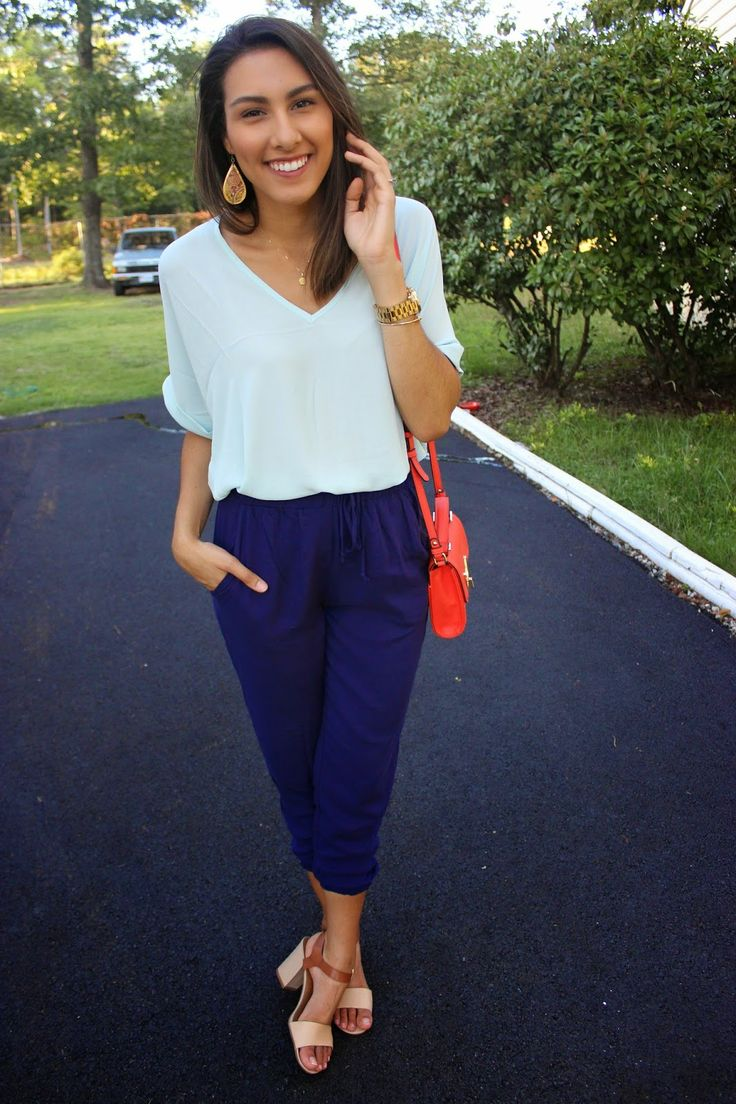 Wear a light blue v-neck t-shirt and navy capri pants for a standout ensemble. Polish off the ensemble with beige leather heeled sandals.  Shop this look by @wendycarela for $116:  http://lookastic.com/women/looks/v-neck-t-shirt-and-watch-and-earrings-and-crossbody-bag-and-capri-pants-and-heeled-sandals/3327  — Light Blue V-neck T-shirt  — Gold Watch  — Gold Statement Earrings  — Red Leather Crossbody Bag  — Navy Capri Pants  — Beige Leather Heeled Sandals