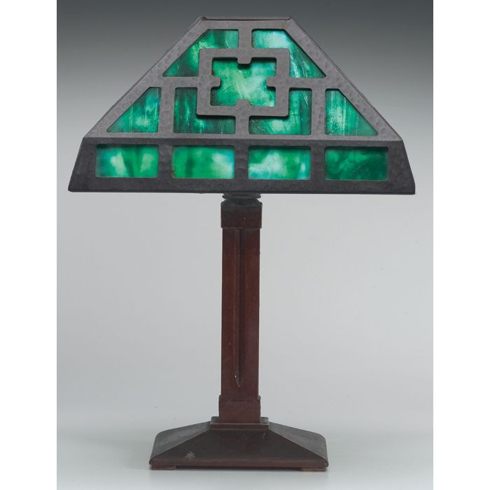 Gustav Stickley lamp base, supporting an Arts & Crafts hammered metal and green glass shade