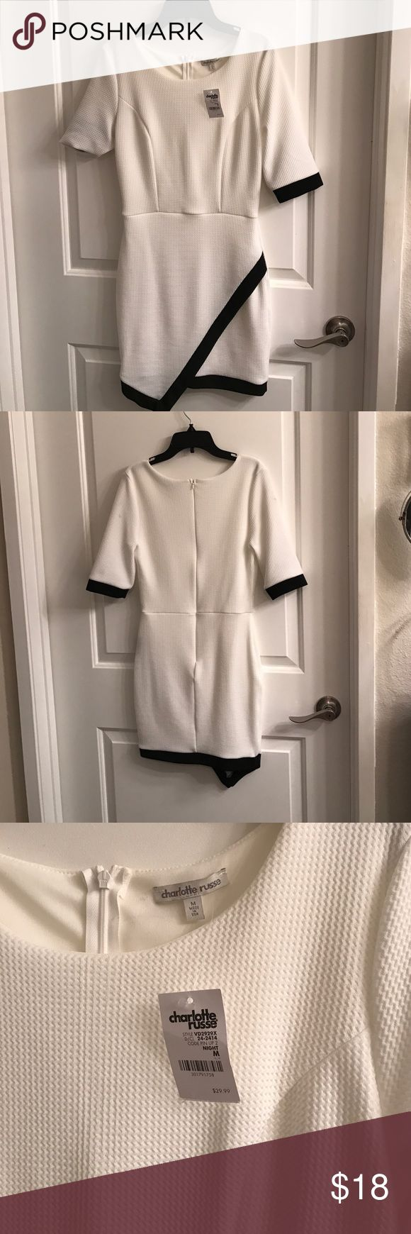 White body con dress White body con dress from Charlotte Rousse. Never got around to wearing it so it still has the tags, original retail $29.99. Has two little stains on each shoulder, try removing with shout wipes? Charlotte Russe Dresses Mini