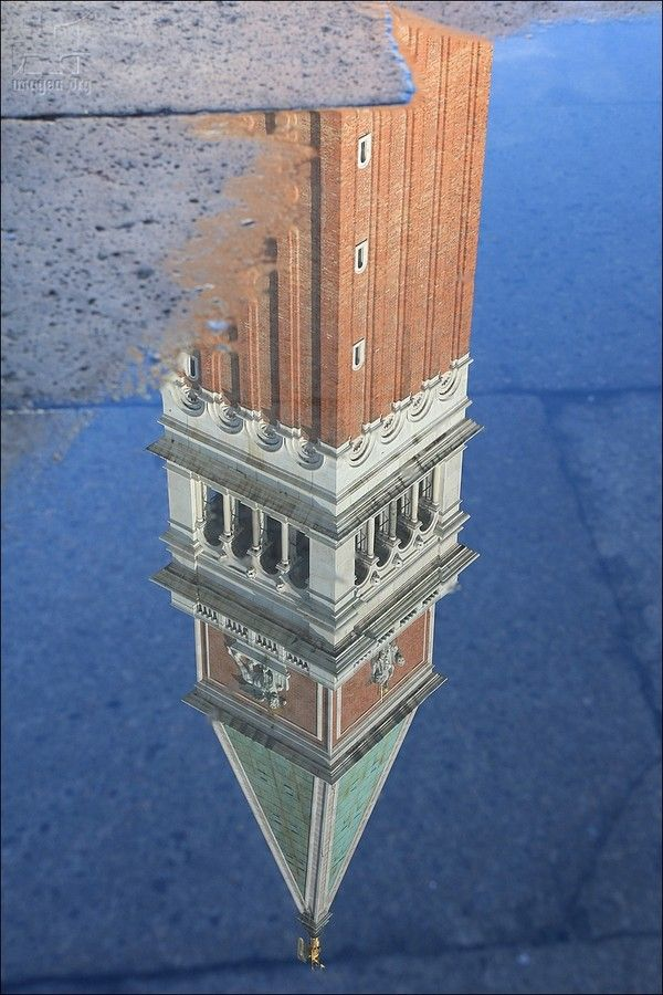 St Mark's Campanile reflection - The tower is 98.6 metres tall - The current tower was reconstructed in its present form in 1912 after the collapse of 1902 - San Marco sestiere - Venezia - Veneto - Italy