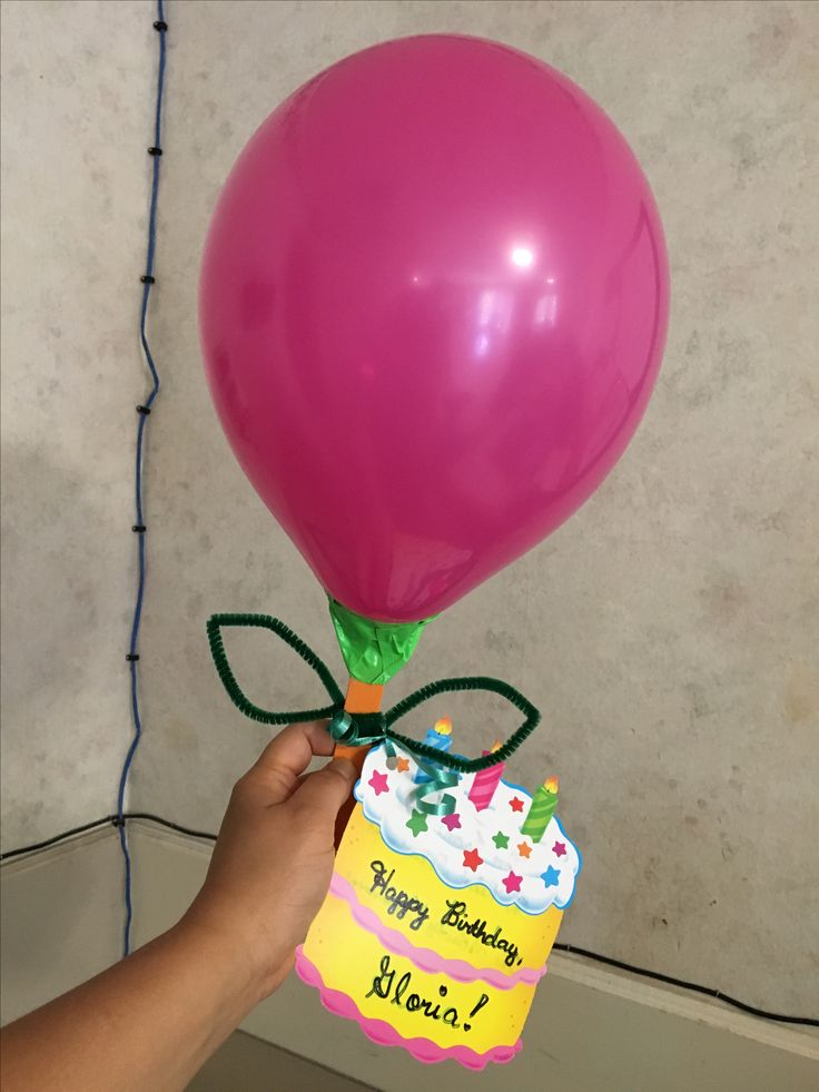 Balloon for petal or head of flower, green pipe cleaner for leaves, popsicle stick for stem, green duct tape for sepal which serves as a  stabilizer when you attach balloon to the popsicle stick and to make balloon stand.