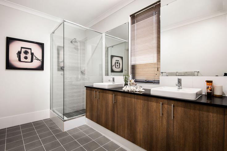 Ensuite featuring twin vanity basinswith semi-inset vanity basins, mixer taps and glass semi-frameless pivot screen doors