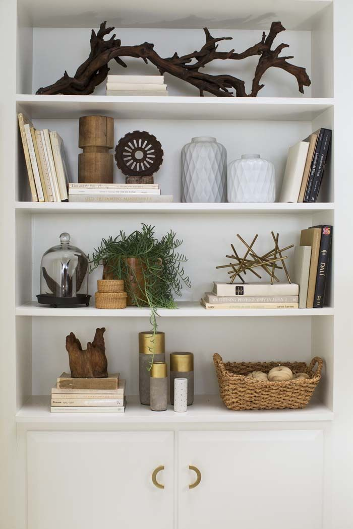 short baskets for paper storage... branch to tie in some other nature pieces... White shelves to let other things pop.