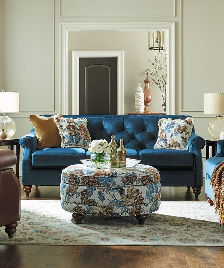 Opt for a generous round ottoman instead of a typical coffee table, like the La-Z-Boy Coronet Premier Storage Ottoman. Upholstered in a graphic, large-scale floral with matching pillows, the overall effect is pretty — but not too precious for sitting back and putting up your feet. Plus, PIN TO WIN! Get contest details at http://houseandhome.com/la-z-boy | #LaZBoy #Furniture #LivingRoom