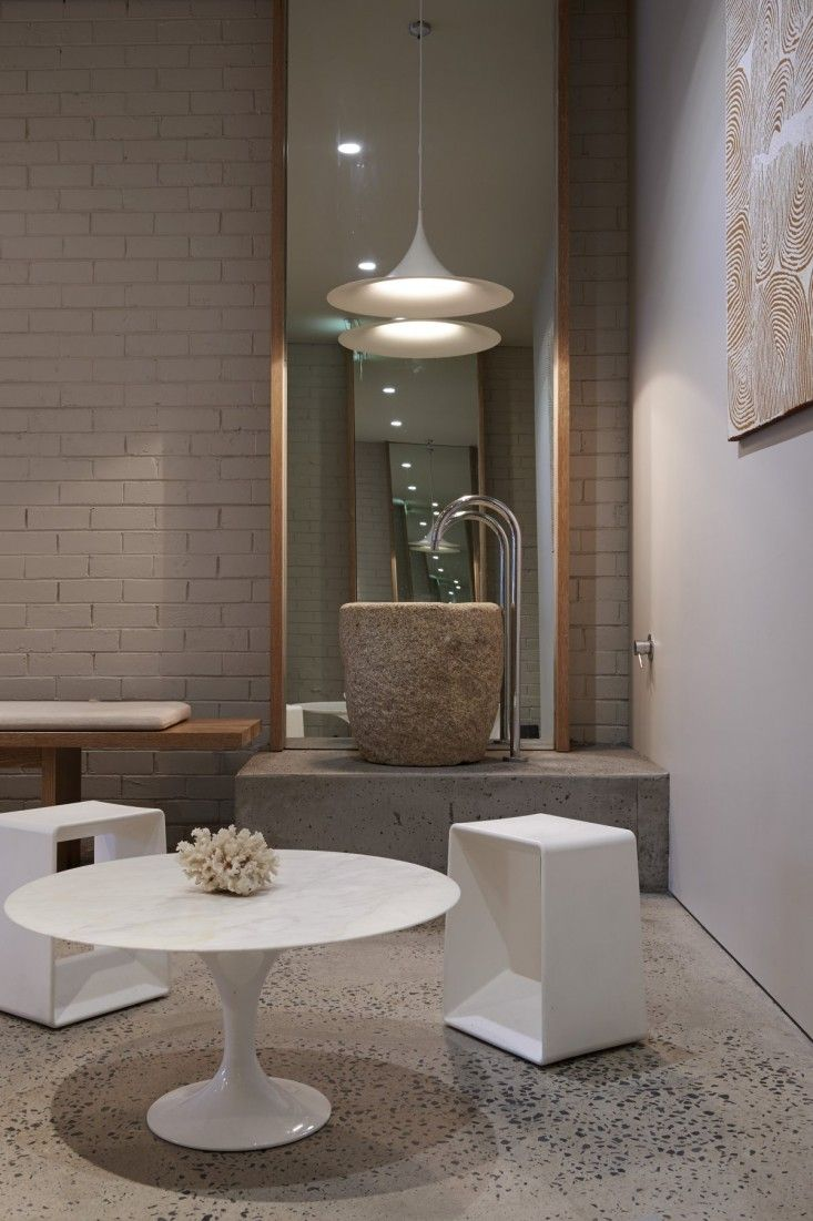 For Filling up water bottle: a fountain made from a Japanese stone grain bowl. Blissed Out: A Serene Yoga Studio in Australia - simple beautiful design....