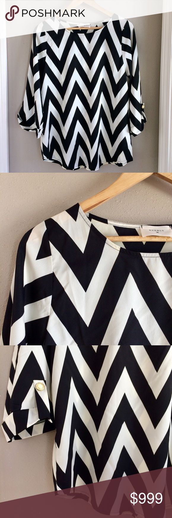 L Everly Chevron Top L Everly Chevron Top. Black and white. Cropped, cuffed sleeve with gold and white button detail. So pretty for date night, work or a holiday party. Absolutely darling top! Everly brand sold at . Excellent preowned condition, looks brand new. Bundle for additional discounts and seller offers. Everly Tops