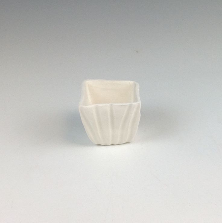 Small cup with ridges   https://artroom14.wordpress.com/student-galleries/emma/
