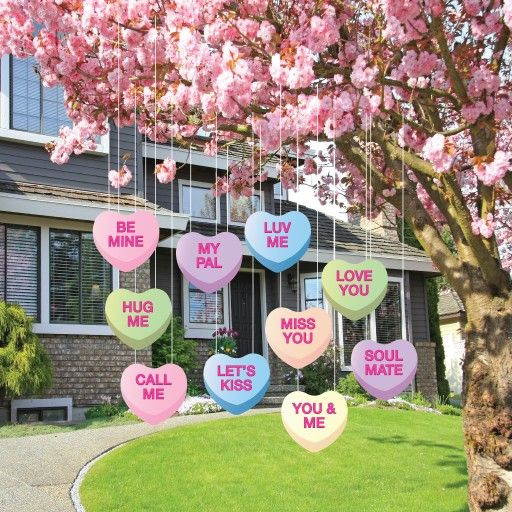 outdoor valentine hanging candy heart decorations on tree