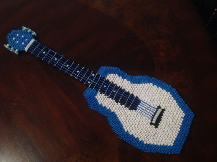 Six string acoustic guitar made of paper