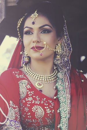 Statement hair and make up by Lajeen Artistry - South Asian Bridal Hair & Makeup Artist in Melbourne - Indian bride - green eyeliner - bridal make up - bridal hair - maang tikka - nath - nose ring #thecrimsonbride