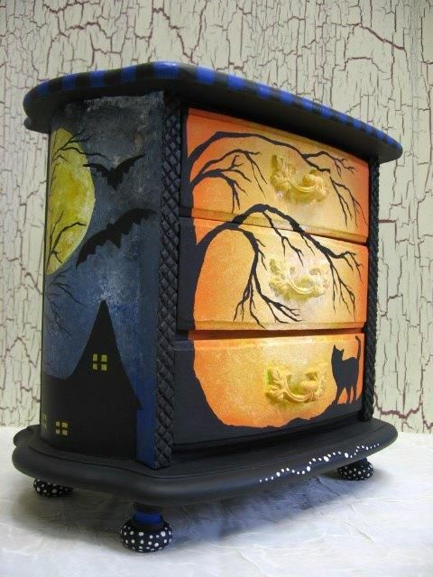 Halloween mural dresser! Amazing! (Something like this would be cool to store smaller Halloween decorations in, maybe ones that are breakable, or kitchen things like all the Halloween cookie cutters, pans, and dishes, or maybe Halloween linens etc)