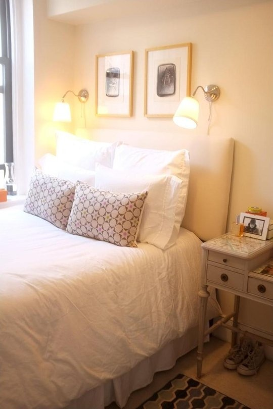 Teeny-Tiny #ikea wall lamps hung as sconces above upholstered headboard