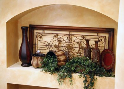 Tuscany accessories - interpreted *** for recessed LR arch: consider a lg piece of mirrored ironwork maybe with 3 small staggered ledges for objects, greenery, etc