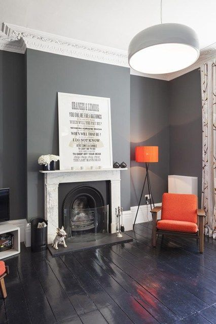 Real Home in Hackney - Living Room Design Ideas & Pictures (http://houseandgarden.co.uk) Love the contrast of dark wall and floors with the striking orange chair!